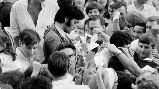 "Elvis Presley signs autographs at Graceland on Sunday, June 8, 1969. in March and April, Elvis was at work in Hollywood on his 31st, and what would be his last, acting role in a motion picture for ""Change of Habit"" with Mary Tyler Moore."