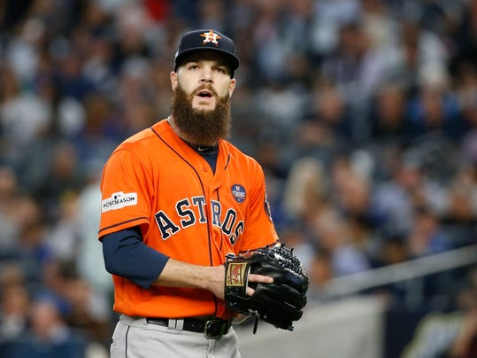 FILE - In this Oct. 18, 2017, file photo, Houston Astros starting pitcher Dallas Keuchel walks back to the dugout after the third inning of Game 5 of the baseball team's American League Championship Series against the New York Yankees in New York. Keuchel agreed to a $13.2 million, one-year contract after helping lead Houston to its first World Series title. Pitchers Lance McCullers Jr. and Brad Peacock and catcher Evan Gattis also reached one-year deals Friday, Jan. 12, when players and teams were set to swap proposed salaries in arbitration. (AP Photo/Kathy Willens, File)