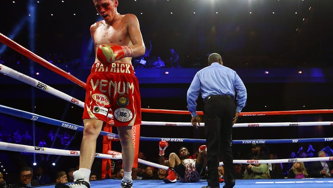 Patrick Teixeira walks to the corner after knocking Carlos Adames to the canvas during their bout last November.