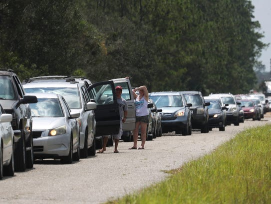 Southwest Florida residents wait in line to receive