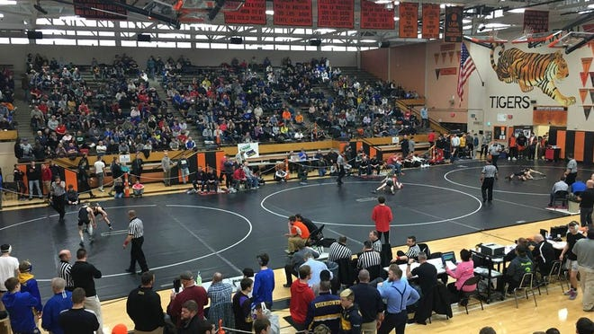 A big crowd gathered for the second day of the District 10 Class 2A wrestling championships, Feb. 23, 2019, at Sharon High School. On Monday, the PIAA board approved a motion to reduce the weight classes from 14 to 13 on a second reading basis. The board will need to approve it one more time in July for it to take effect.
