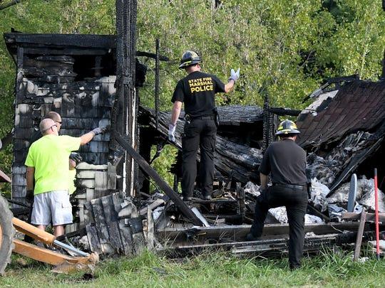 Multiple law enforcement agencies sift through debris