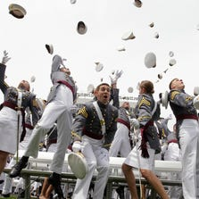 Graduates of the U.S. Military Academy in West Point celebrate at the end of the commencement in 2010.