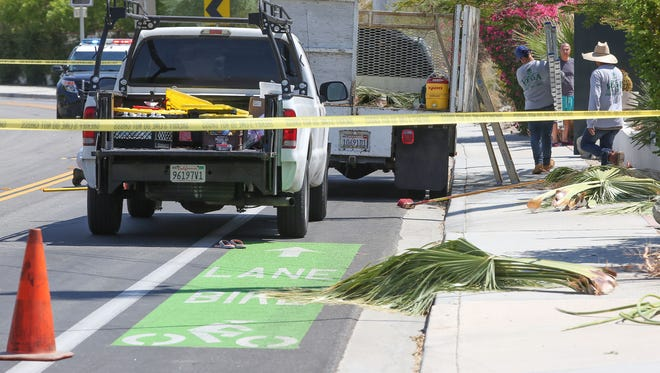 A cyclist died after striking the landscaping vehicle, right, that was parked in the bike lane on a fast downhill section of Avenida Bermudas in La Quinta, June 26, 2017. (Jay Calderon)
