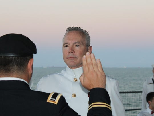 Dr. Troy Creamean swears in during his commissioning