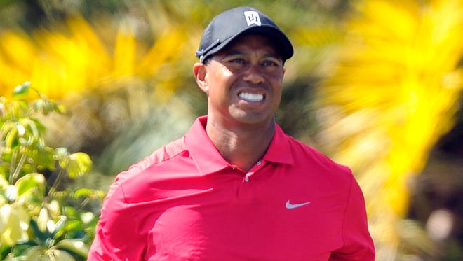 Tiger Woods grimaces after his drive during the final round at the Honda Classic.