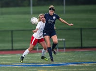 Cumberland Valley Christian School's Emily Bard and Shalom Christian Academy's Emily Martin battle for possession of the ball during a girls soccer game against Shalom on Thursday, April 27, 2017.