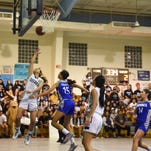 Kiersten Pangelinan (32) of the Academy of Our Lady of Guam Cougars makes the layup against the Notre Dame Royals during their Independent Interscholastic Athletic Association of Guam Girls' Basketball League game at the Academy Gym in Hagatna on Nov. 23.