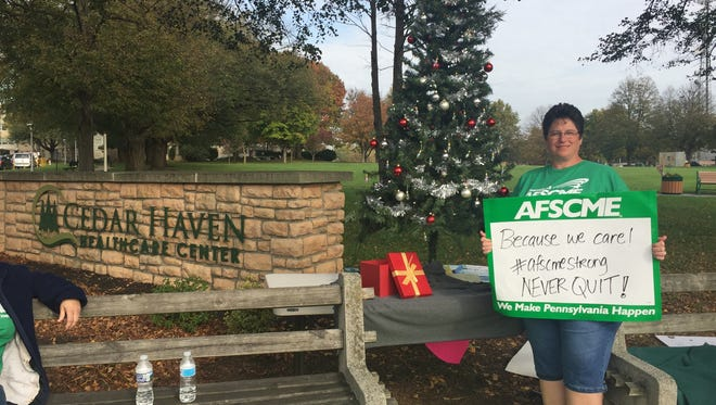 AFSCME Local 2732 President Penny Kleinfelter placed this Christmas tree along the Fifth Avenue picket line for Cedar Haven nurses. Many of the nurses wrote their names on decorations on the tree. The strike entered its third week on Friday afternoon.