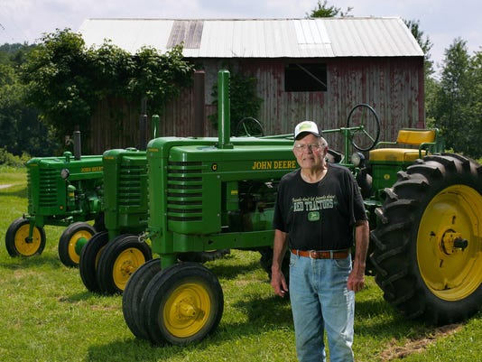 Sam Wyler and his John Deere tractors at his Fresno farm.