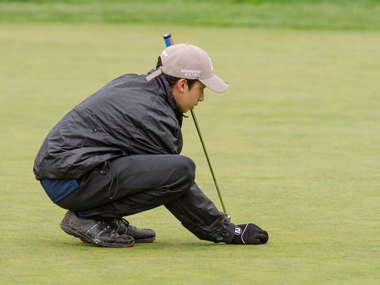 Getting a read on how to approach his next putt is