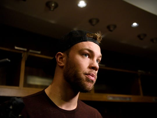 New Jersey Devils forward Taylor Hall speaks with the