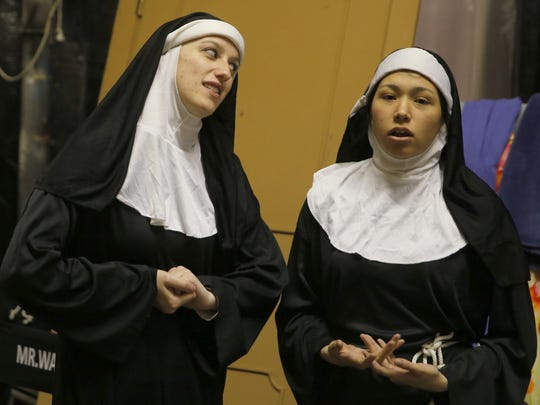 """Dakota Davis, left, and Kiana Poafpybitty are featured in a scene from the Theater Ensemble Arts production of """"Drinking Habits 2: Caught in the Act."""""""