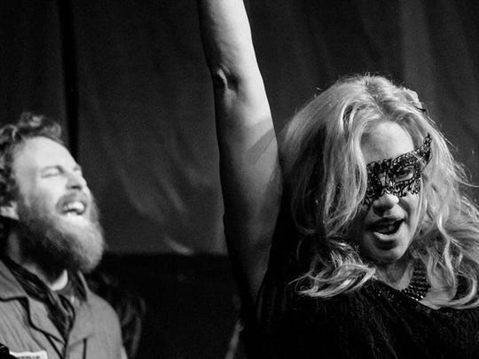 """In concert at Third Avenue Playhouse in Sturgeon Bay, Adam Mackintosh and Andrea Wittgens play one of the brand new Halloween-themed songs written during last year's """"Dark Songs."""""""
