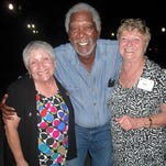 Dixie Mitchell, left, and Holly Healey, right, met Morgan Freeman at Squire Creek Country Club. He was in the area visiting friends.