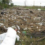Plastic bottles litter a New Jersey marsh in this 2012 file photo.