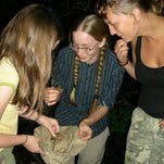 Land of the Sky Wilderness Camp students are excited to show a camp instructor what they have found.