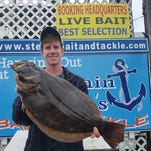 Colin Harrison with a 22.5 inches 4.11 pound flounder caught in the chincoteague channel using a white east coast flounder rig.