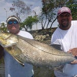 "Orlando snook fishing guide Ward Michaels, left, landed this 60-pound Pacific snook off the west coast of Costa Rica and he needed help from Costa Rican fisherman ""Big John"" in showing it off. The catch is a potential all-tackle world record with the International Game Fish Association (IGFA), meaning it would be the heaviest Pacific snook ever registered if it is approved."