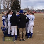Havre softball players gather around their coaches at Saturday's jamboree at Multi-Sports Complex.