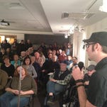 Documentary filmmaker Rusty Tagliareni of Antiquity Echoes speaks to a capacity crowd at Preserve Greystone's annual meeting Thursday at the Morristown and Morris Township Library.