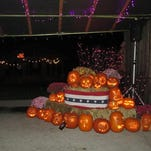 Americana Vineyards staffers carve pumpkins for the Hallowine Spook-tacular.