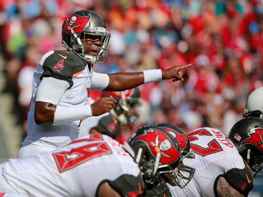 Sep 13, 2015; Tampa, FL, USA;Tampa Bay Buccaneers quarterback Jameis Winston (3) points against the Tennessee Titans during the first quarter at Raymond James Stadium. Mandatory Credit: Kim Klement-USA TODAY Sports