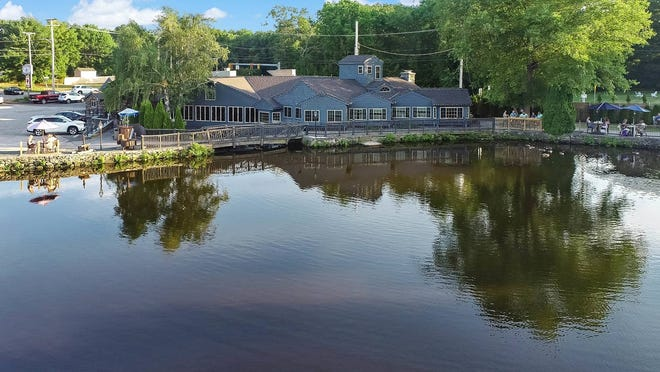 The asking price for the Old Grist Mill Tavern in Seekonk, which repoened in 2014 two years after a catastrophic fire, is $3 million. Meanwhile, the tavern's owner is saying that it's business as usual at the restaurant in the meantime.