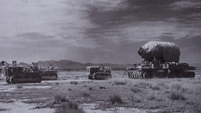 "Military personnel are seen moving ""Jumbo"" to Trinity Site."