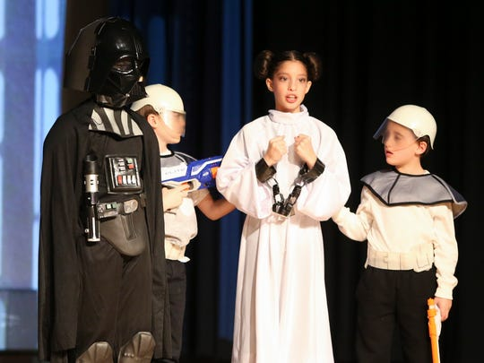 "Ben as Darth Antiochus interrogates Mai as Princess Leah Maccabeea as Albert Einstein Academy students take part in the Hanukkah/Star Wars mashup production ""Star (of Judah) Wars"" at the Siegel JCC Thursday."