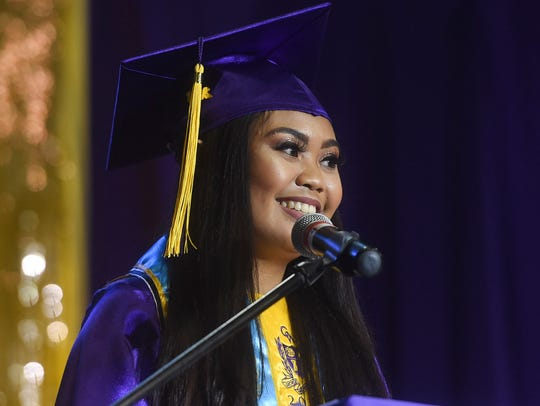 Valedictorian Lisa Rose Rosario, 18, gives her valedictory