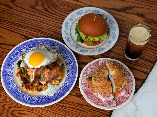 The menu at Cardinal Provisions includes, clockwise from top, a fried egg sandwich with avocado, cheddar and greens; an everything bagel with beet horseradish cream cheese, house-cured salmon, capers, red onions and herbs, and chicken and waffles.