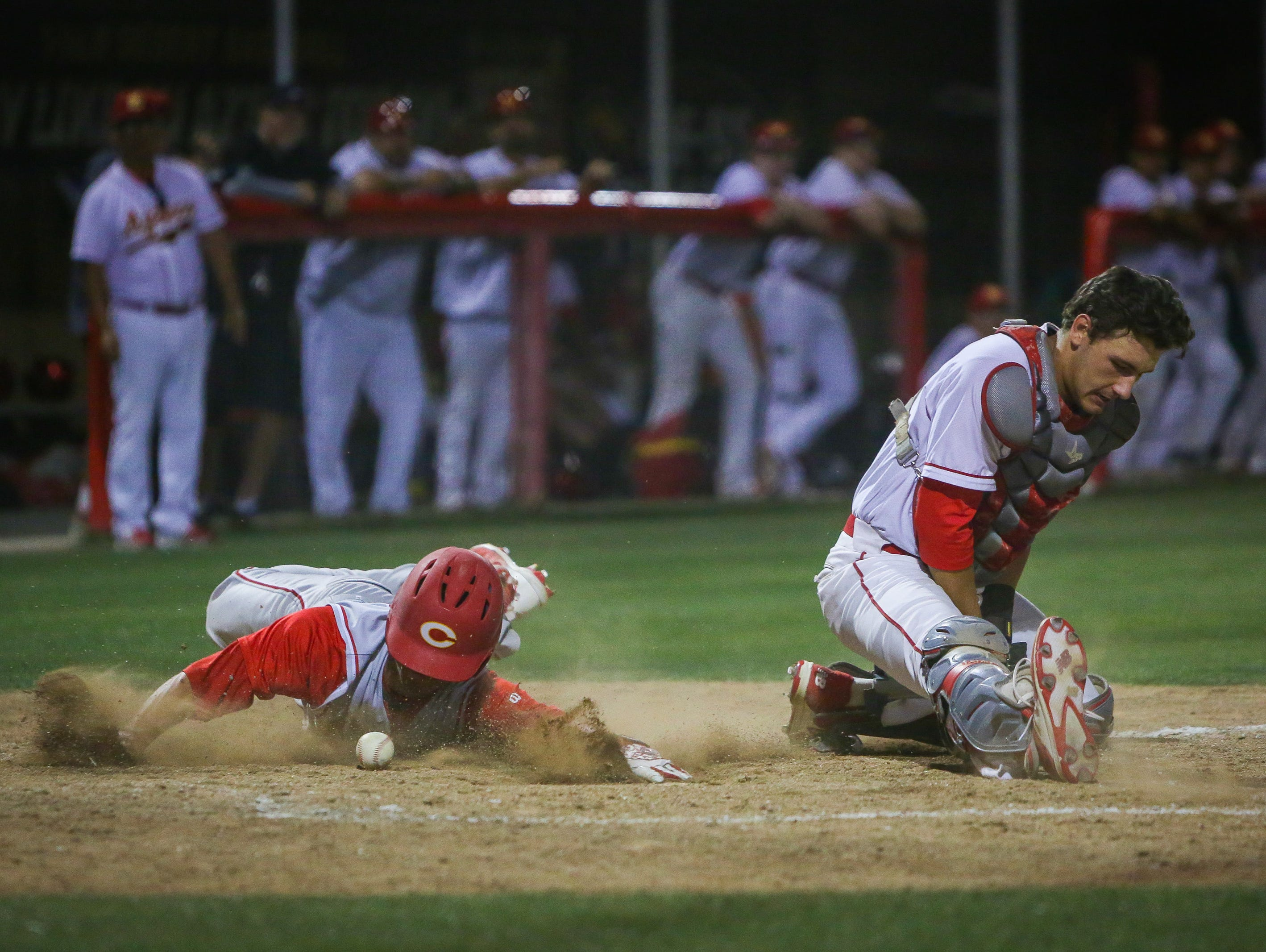 Corona's Chase Robison slides and scores.