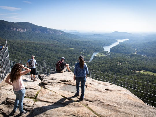 Visitors to Chimney Rock State Park take in the eastern