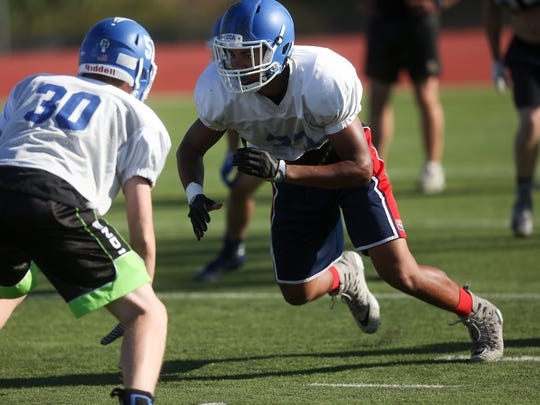 Clear Creek Amana's T.J. Bollers runs plays during