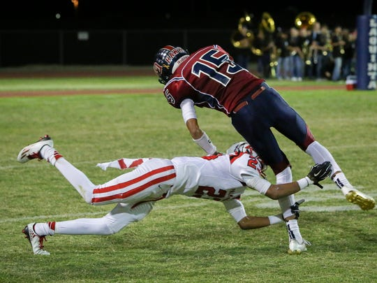 Mike Howard with the tackle. La Quinta defeats Palm
