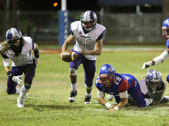 """Jason """"JD"""" Lang strips the ball from David Alvarado. Shadow Hills 32, Indio 13 -- The Mayor's Cup will stay with the Knights!"""
