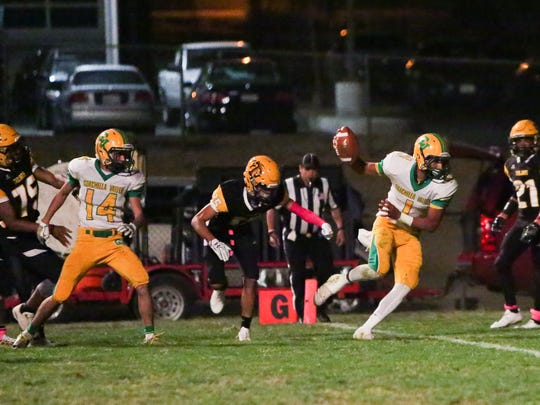 Armando Deniz keeps the ball and runs to the left and walks right in the end zone. Touchdown! The Coachella Valley varsity football team won Thursday's away conference game against Yucca Valley by a score of 29-28.
