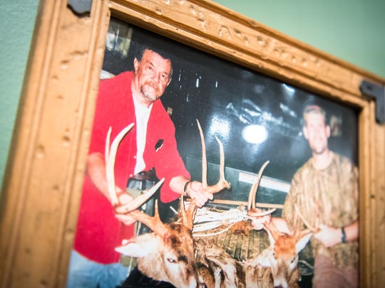 A photo of Tommy Bryson with his son Joey Bryson, hanging in the home of Joey Bryson and his wife April.