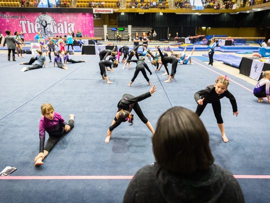 Athletes from one of 40 teams competing in the Gymnastics
