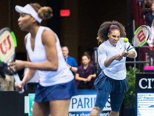 American tennis stars Venus and Serena Williams playing for the U.S. against The Netherlands during Fed Cup in February 2018 at Asheville's U.S. Cellular Center.