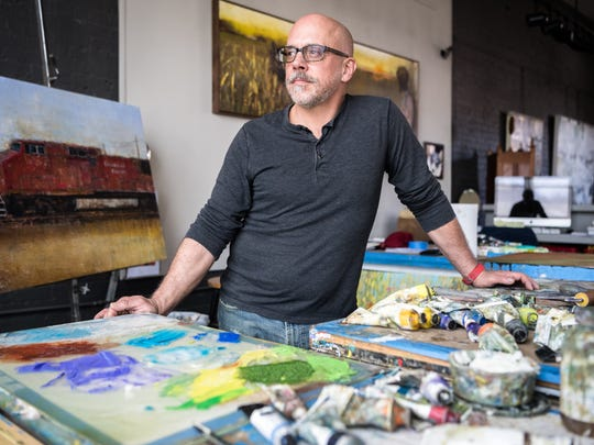 Mark Bettis, a fine art painter, in his studio in the