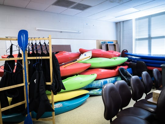 Stacks of kayaks in a classroom at Southwestern Community