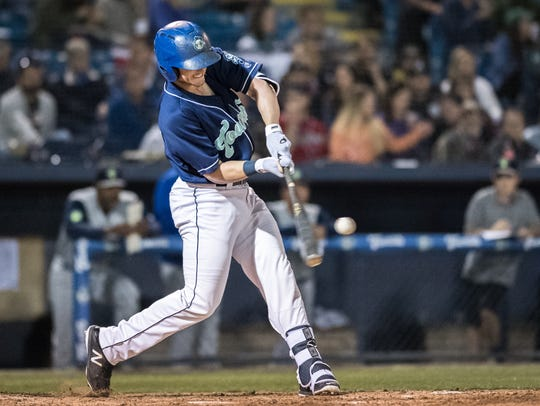 The Asheville Tourists' Casey Golden hits one of the
