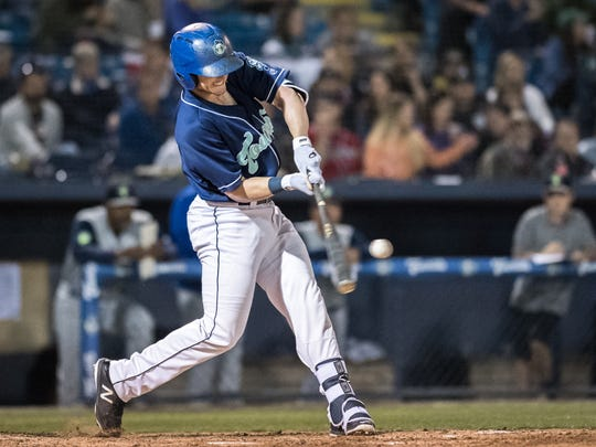 The Asheville Tourists' Casey Golden hits one of the Tourists' home runs during their season opener against the Columbia Fireflies Thursday, April 12, 2018.