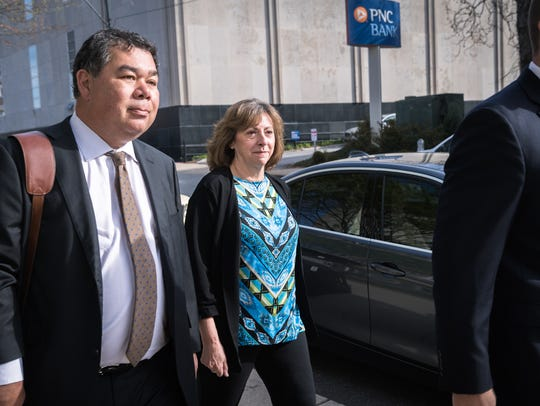 Wanda Greene, former Buncombe County manager, walks to the federal courthouse in Asheville with her attorney Noell Tin, and Thomas Amburgey for her arraignment on her charges of wire fraud, conspiracy, embezzlement and aiding and abetting Friday, April 13, 2018.