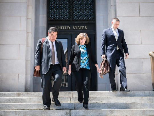 Wanda Greene, former Buncombe County manager, walks leaves the federal courthouse in Asheville with her attorney Noell Tin, and Thomas Amburgey after her arraignment on her charges of wire fraud, conspiracy, embezzlement and aiding and abetting  Thursday, April 13, 2018.