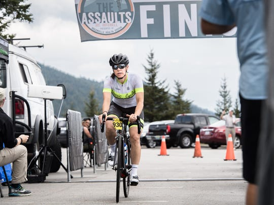 Jenny Leiser, 38, of Charlotte, crosses the finish line of the Assault on Mt. Mitchell as the first woman to finish the 102-mile ride which began in Spartanburg, S.C, for the second year in a row. She finished in 38th place overall with a time of 5:51:43.