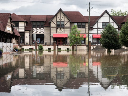 Brook Street in Biltmore Village and an adjacent parking lot sit under water Wednesday, May 30, 2018, as a result of heavy rain throughout Western North Carolina.