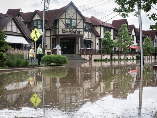 Brook Street in Biltmore Village sits completely under water Wednesday, May 30, 2018, as a result of heavy rain throughout Western North Carolina.